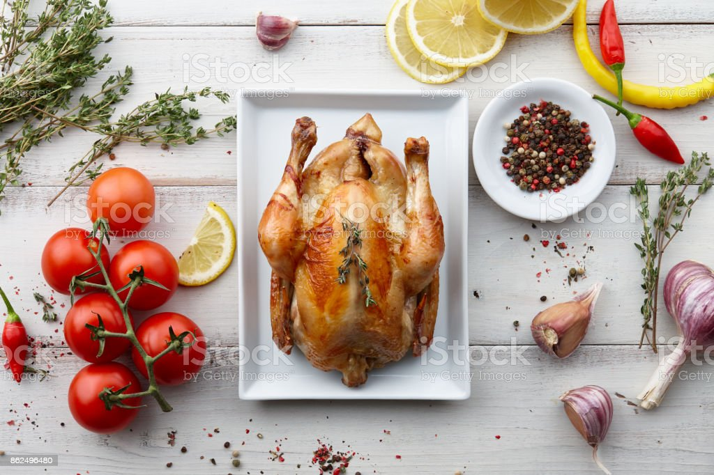 Roasted chicken with herbs and spices for holiday dinner stock photo