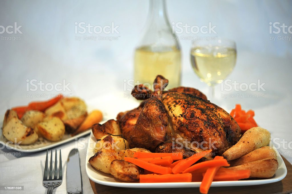 Roasted chicken with roast vegetables and white wine royalty-free stock photo