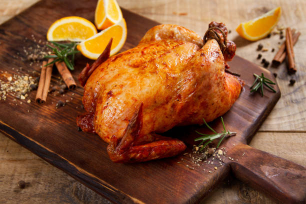 Roasted chicken with spices stock photo
