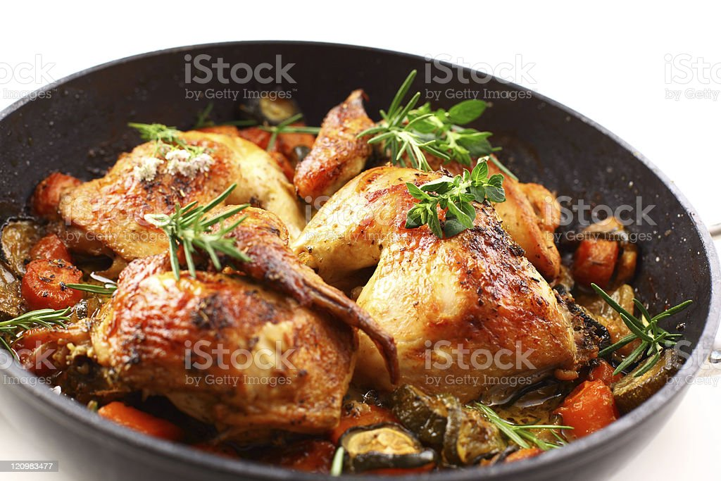 Roasted chicken with vegetable stock photo