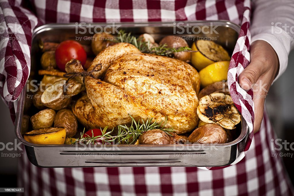 Roasted Chicken with Vegetables in Roasting Tin stock photo