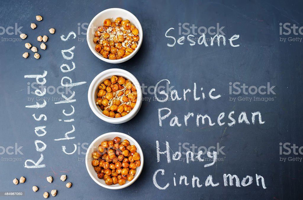 roasted chickpeas in different flavors stock photo