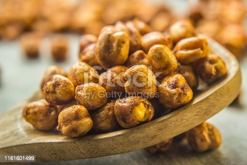 Roasted chickpeas snack texture . Food background photo