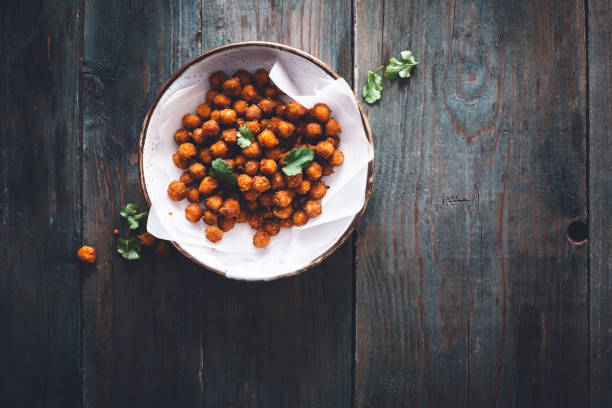 Roasted chickpeas with spices Cumin and Paprika for aperitif Pois Chiches Grillés aux Epices Cumin et Paprika pour l' Apéritif chick pea stock pictures, royalty-free photos & images