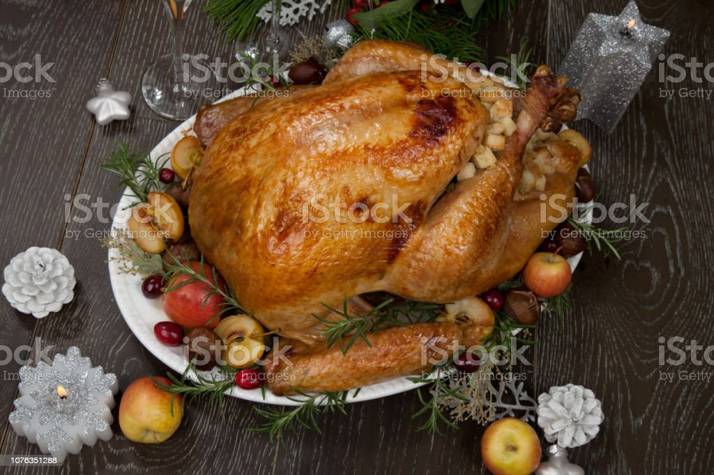 Garnished roasted Christmas turkey with grab apples, sweet chestnut,...