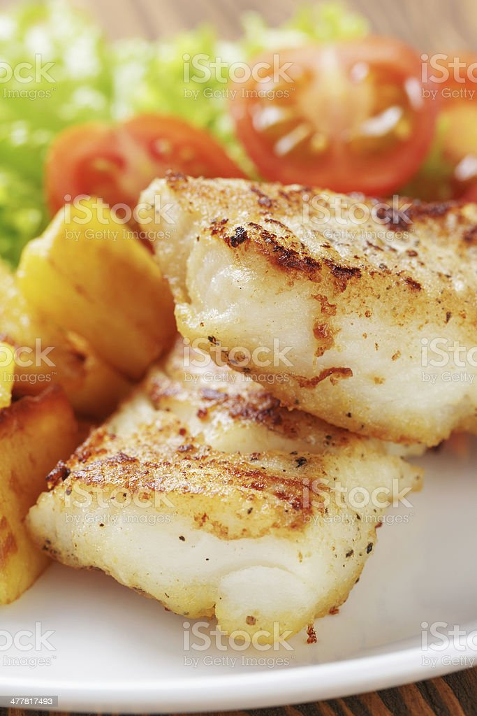 roasted codfish fillet with vegetables stock photo