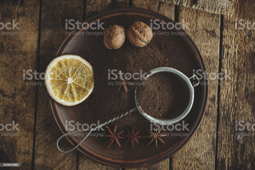 Roasted coffee beans and ground coffee in the plate stock photo