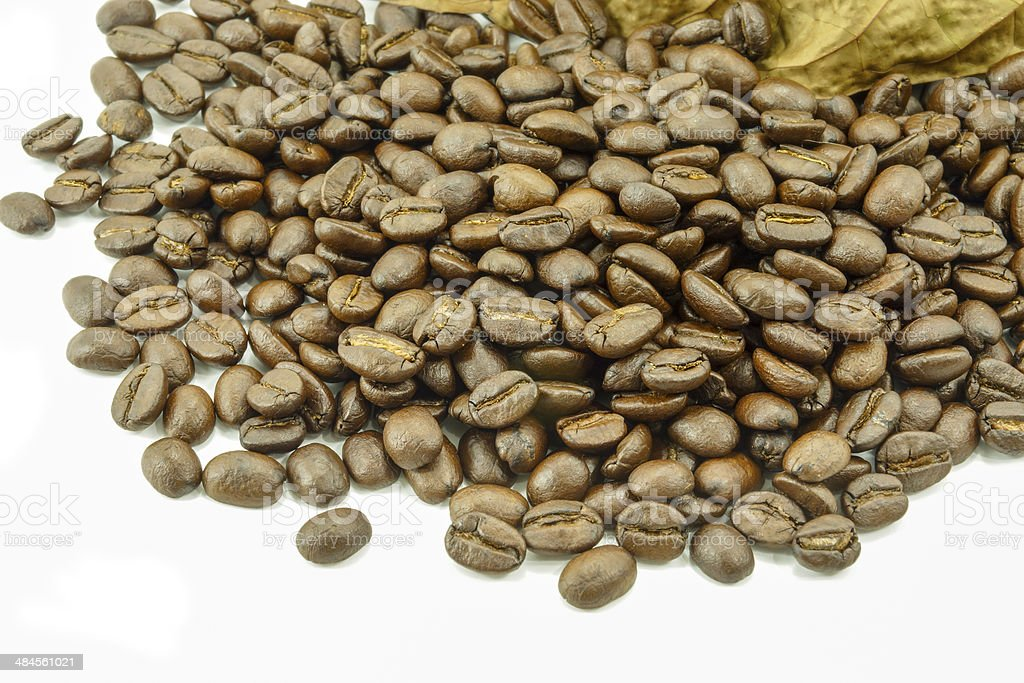 Roasted coffee beans and leaves dry royalty-free stock photo
