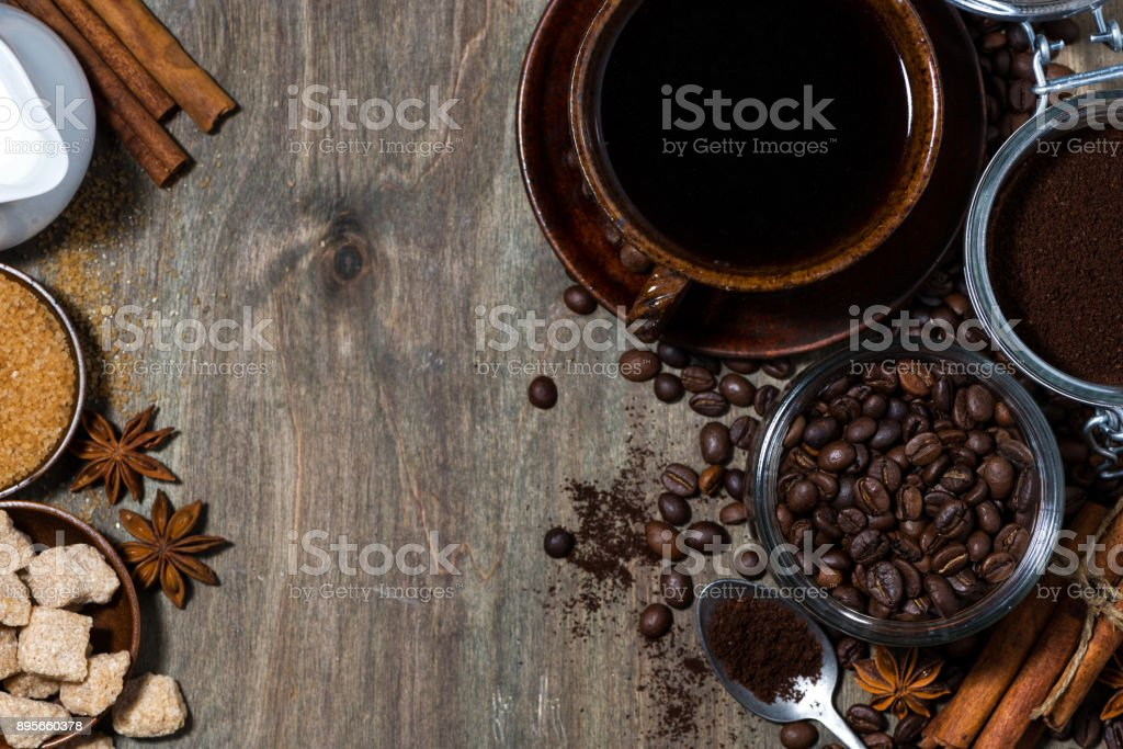 roasted coffee beans and spices on wooden background, concept photo,...