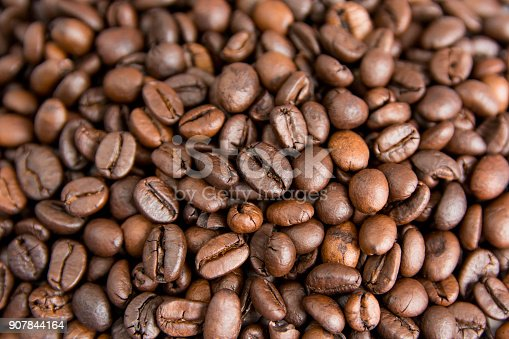 istock Roasted Coffee Beans background, Brown coffee beans for can be used as a background 907844164