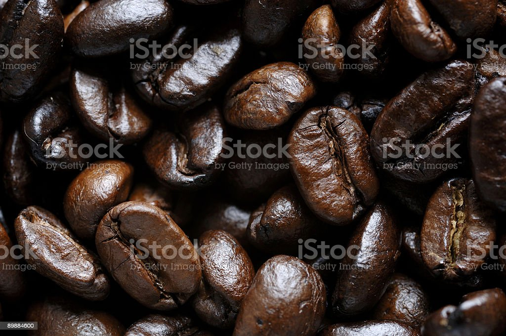 roasted coffee beans close up royalty-free stock photo