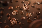 Roasted coffee beans falling down with copy space