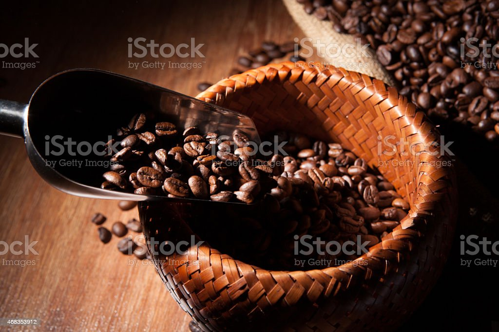roasted coffee beans in a bamboo basket royalty-free stock photo