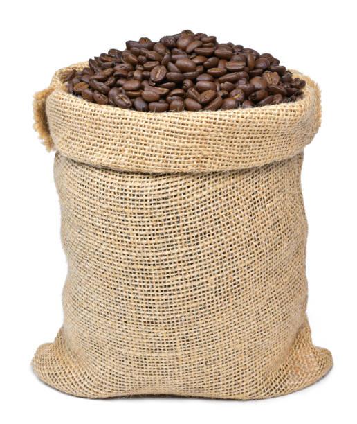 gebrande koffiebonen in een jute zak - zak tas stockfoto's en -beelden