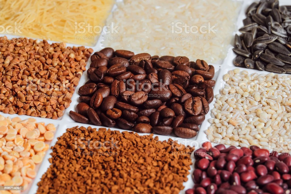 Roasted coffee beans in set of groceries. Background with limited depth of field. stock photo