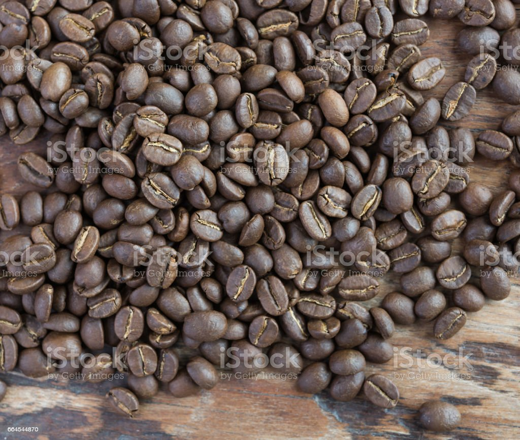 Roasted coffee beans on grunge wood background royalty-free stock photo