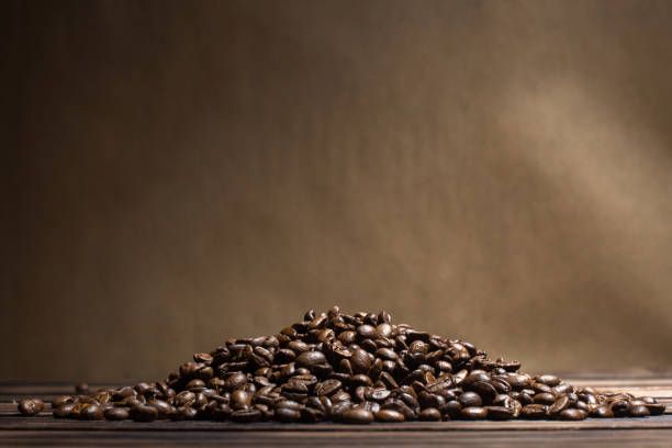 roasted coffee beans - coffee beans stock photos and pictures