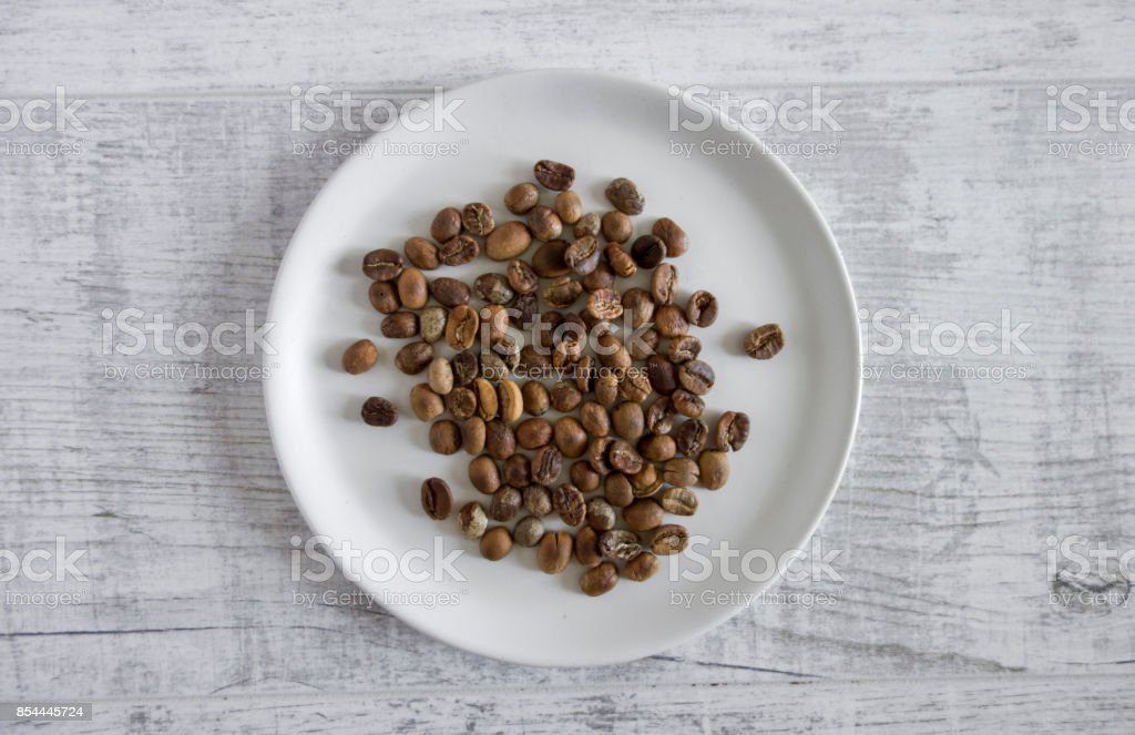3/4 roasted coffee beans stock photo