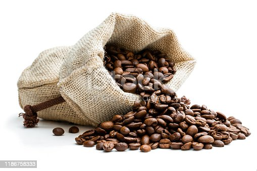 Roasted  coffee beans scattered of the burlap bag isolated on white