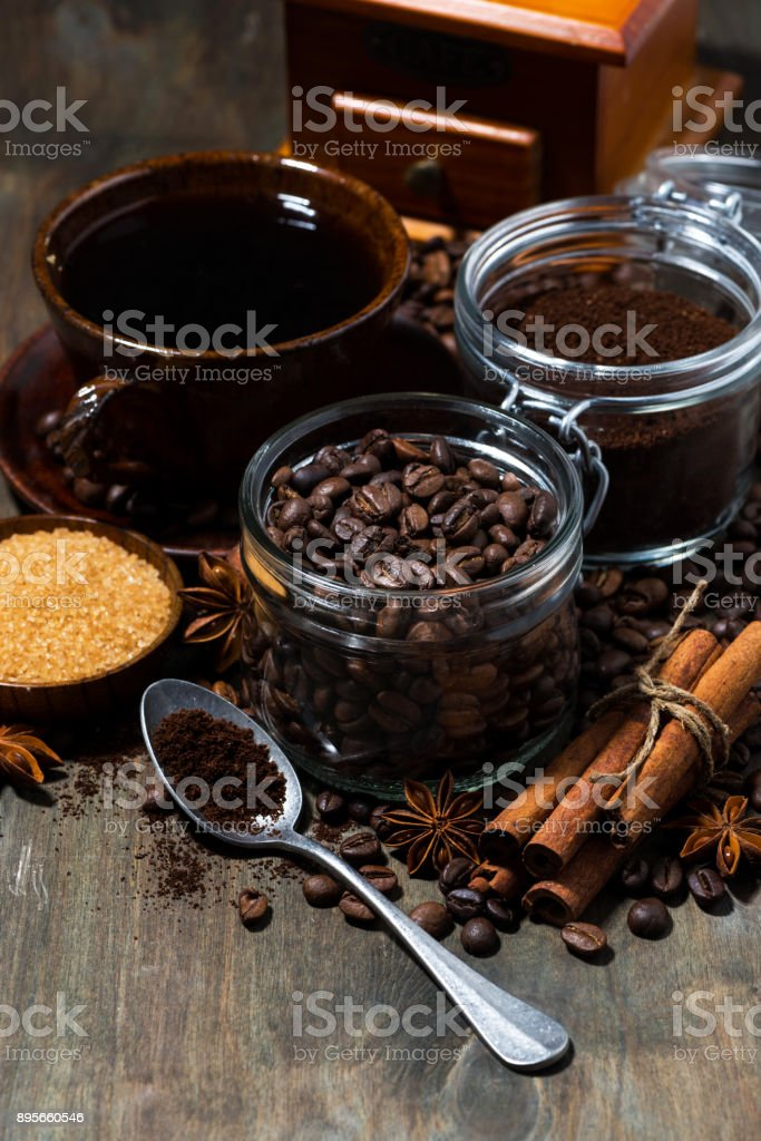 roasted coffee beans, spices and sugar on wooden background, top view