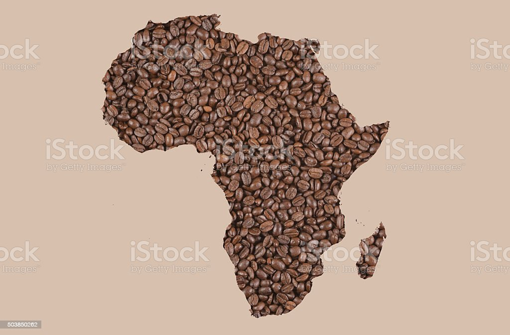 Roasted coffee beans with Africa contour background stock photo