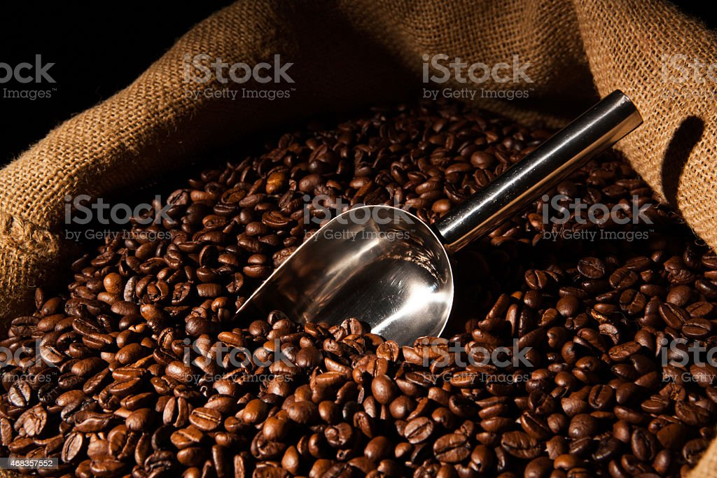 roasted coffee beans with scoop in bag royalty-free stock photo