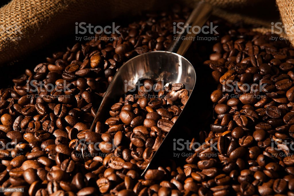roasted coffee beans with scoop royalty-free stock photo