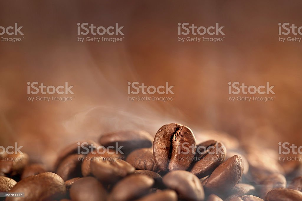 Roasted coffee beans with smoke stock photo