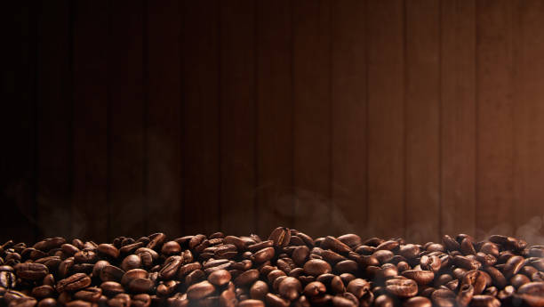 Roasted coffee beans with wooden background, copy space Roasted coffee beans with wooden background, copy space roasted coffee bean stock pictures, royalty-free photos & images