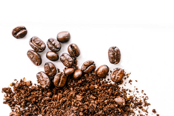 Roasted coffee white background - Concept design Roasted Coffee Bean caffeine stock pictures, royalty-free photos & images
