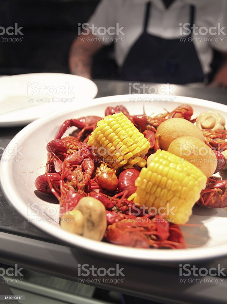 Roasted crawfish with corn on the cob stock photo