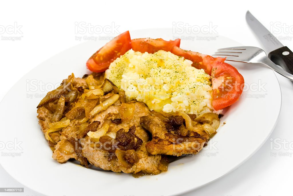 roasted cutlet of pork,with onion and salad royalty-free stock photo