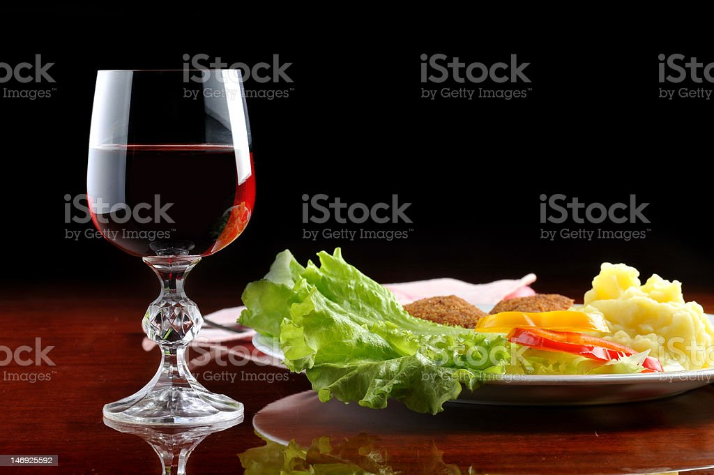 roasted cutlets and  wine royalty-free stock photo
