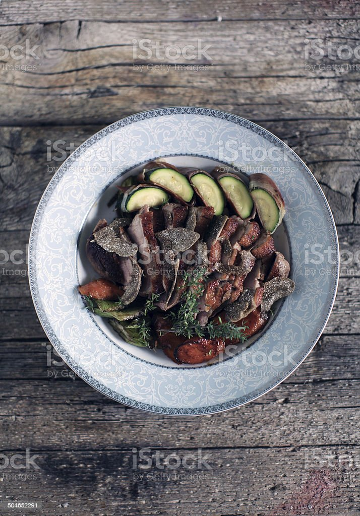 Roasted duck breast fillet with truffles and roasted vegetables stock photo