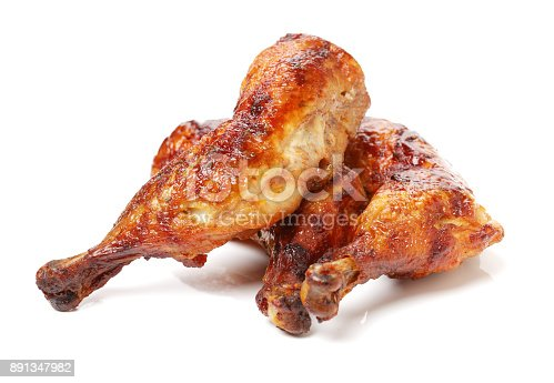 istock Roasted duck legs on the white background 891347982