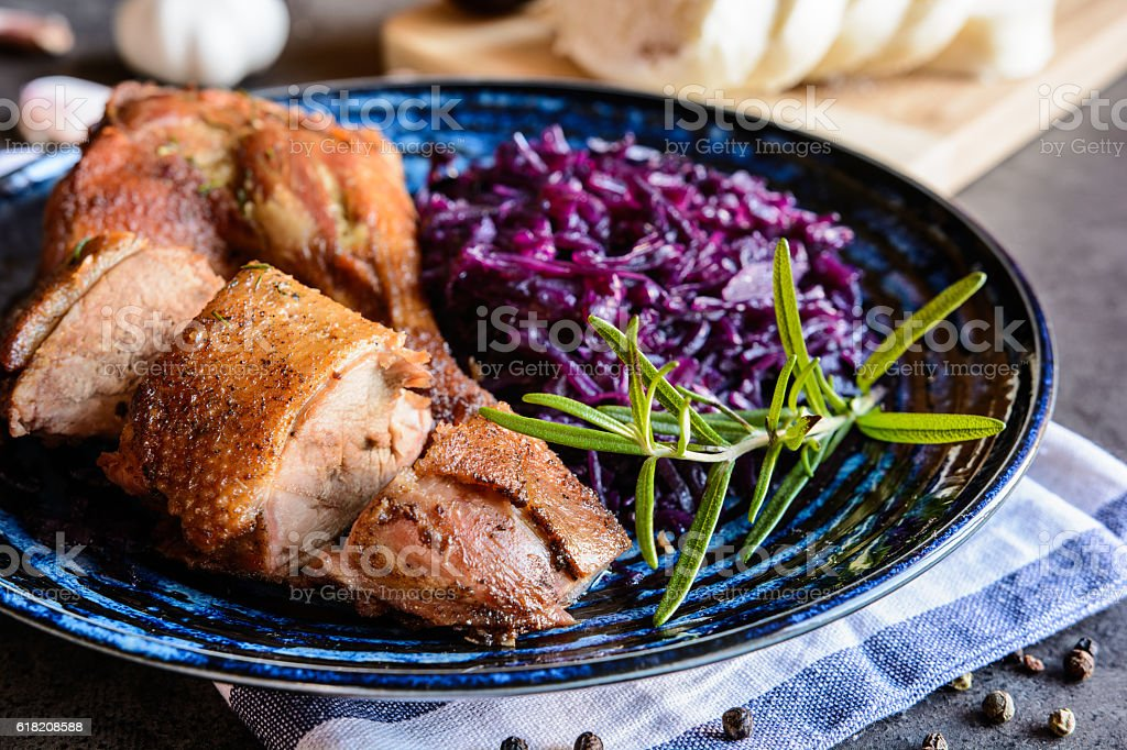 Roasted duck with stewed red cabbage and dumplings stock photo