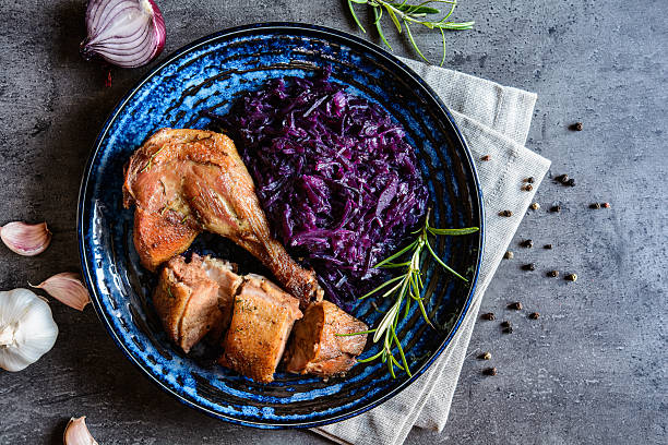 Roasted duck with stewed red cabbage and dumplings Roasted duck leg and breast with stewed red cabbage and dumplings czech culture stock pictures, royalty-free photos & images