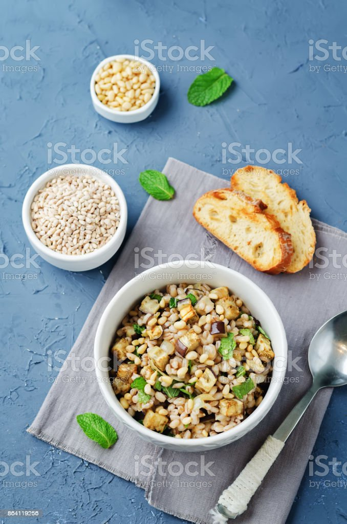 Roasted eggplant pine nuts mint barley salad royalty-free stock photo