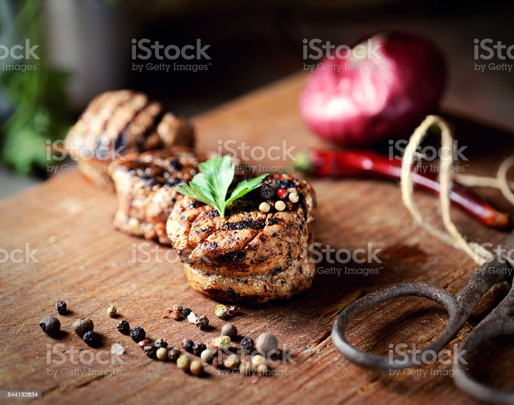 roasted fillet medallion on a wooden background stock photo