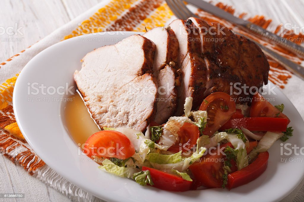 Roasted fillet of turkey and fresh vegetables close-up. Horizontal stock photo