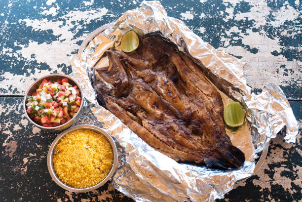 Roasted fish, served with sauce and farofa stock photo