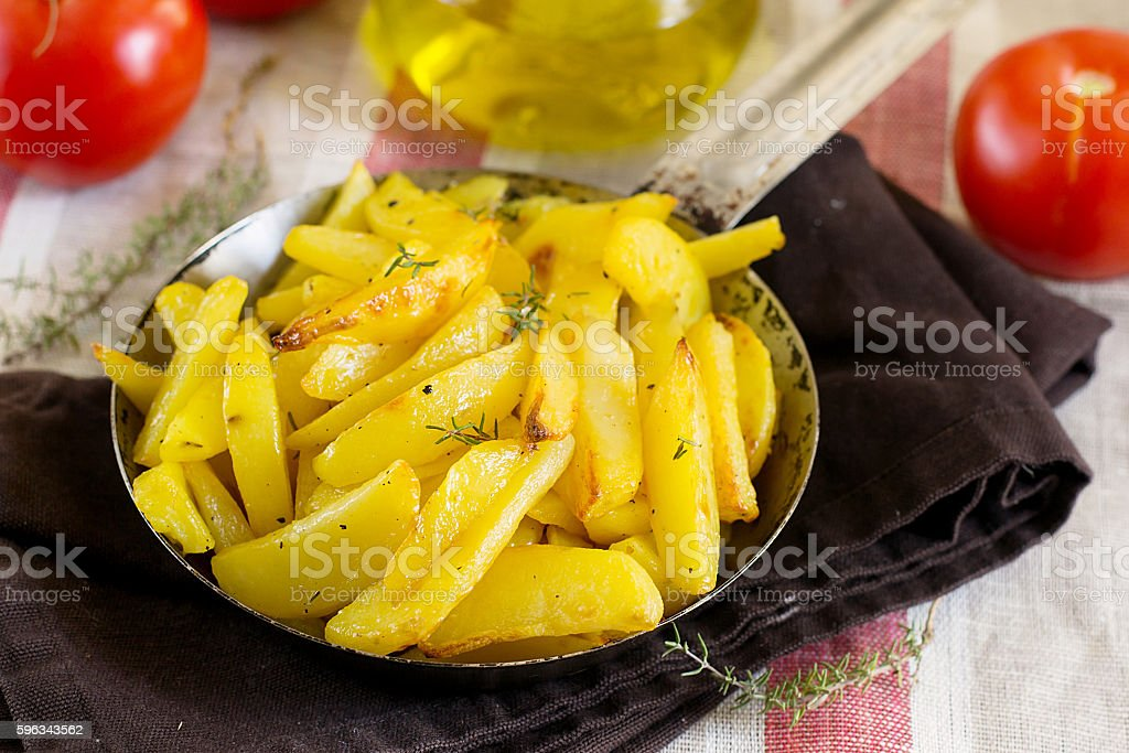 Roasted fried buttery potatoes with thyme royalty-free stock photo