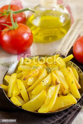 Roasted Fried Buttery Potatoes With Thyme Stock Photo & More Pictures of Butter