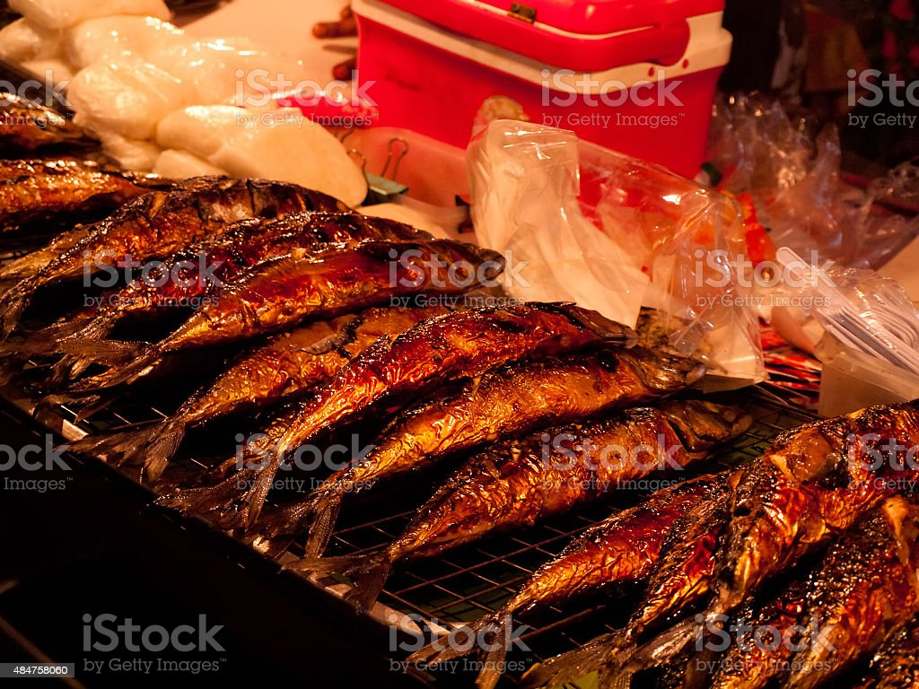 Roasted fried fish as snack street food stock photo