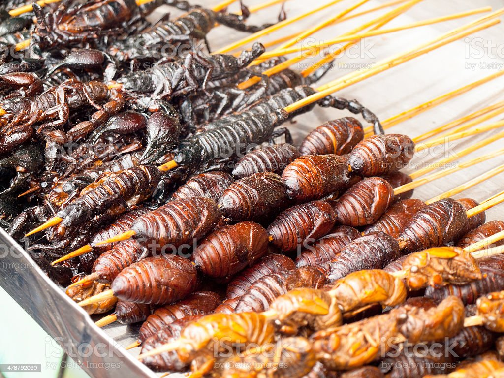 Roasted fried insects and bugs stock photo