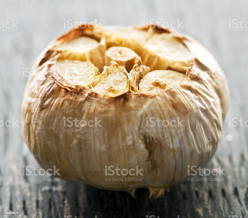 Roasted garlic bulb stock photo