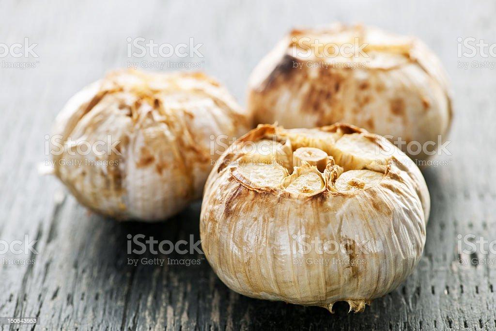 Roasted garlic bulbs stock photo