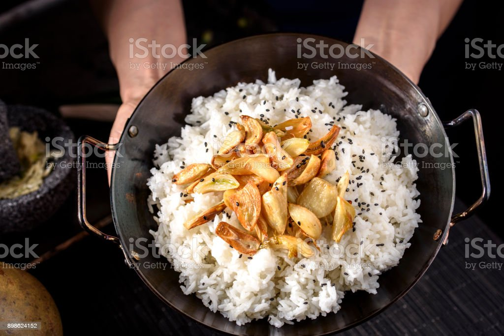 Roasted Garlic over Steamed Rice stock photo