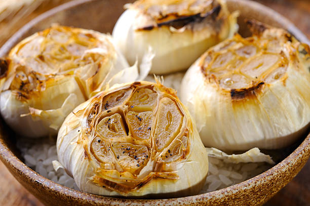 roasted garlic - garlic stock photos and pictures
