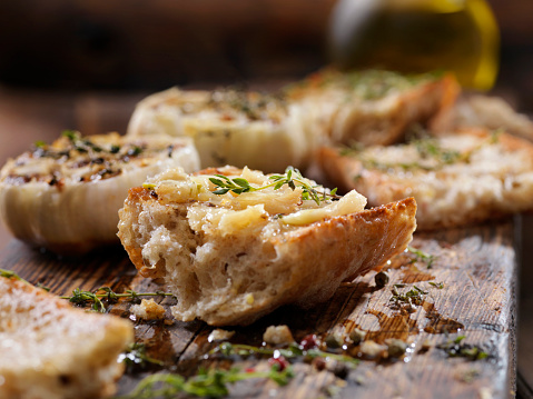 Roasted Garlic Spread on Toasted Baguette with Salt, Pepper, Thyme and Olive Oil